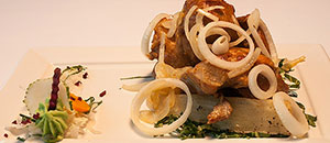 Pork with onions and yuccas.